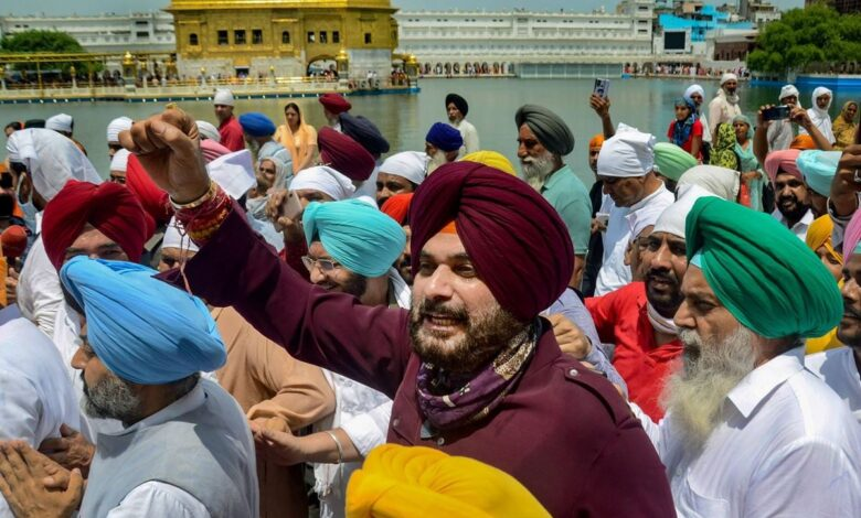 Navjot Singh Sidhu along with party leaders, offers prayers at Golden temple in Amritsar, Wednesday. (PTI)